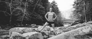 Jenni Hulburt on rocks in the crek