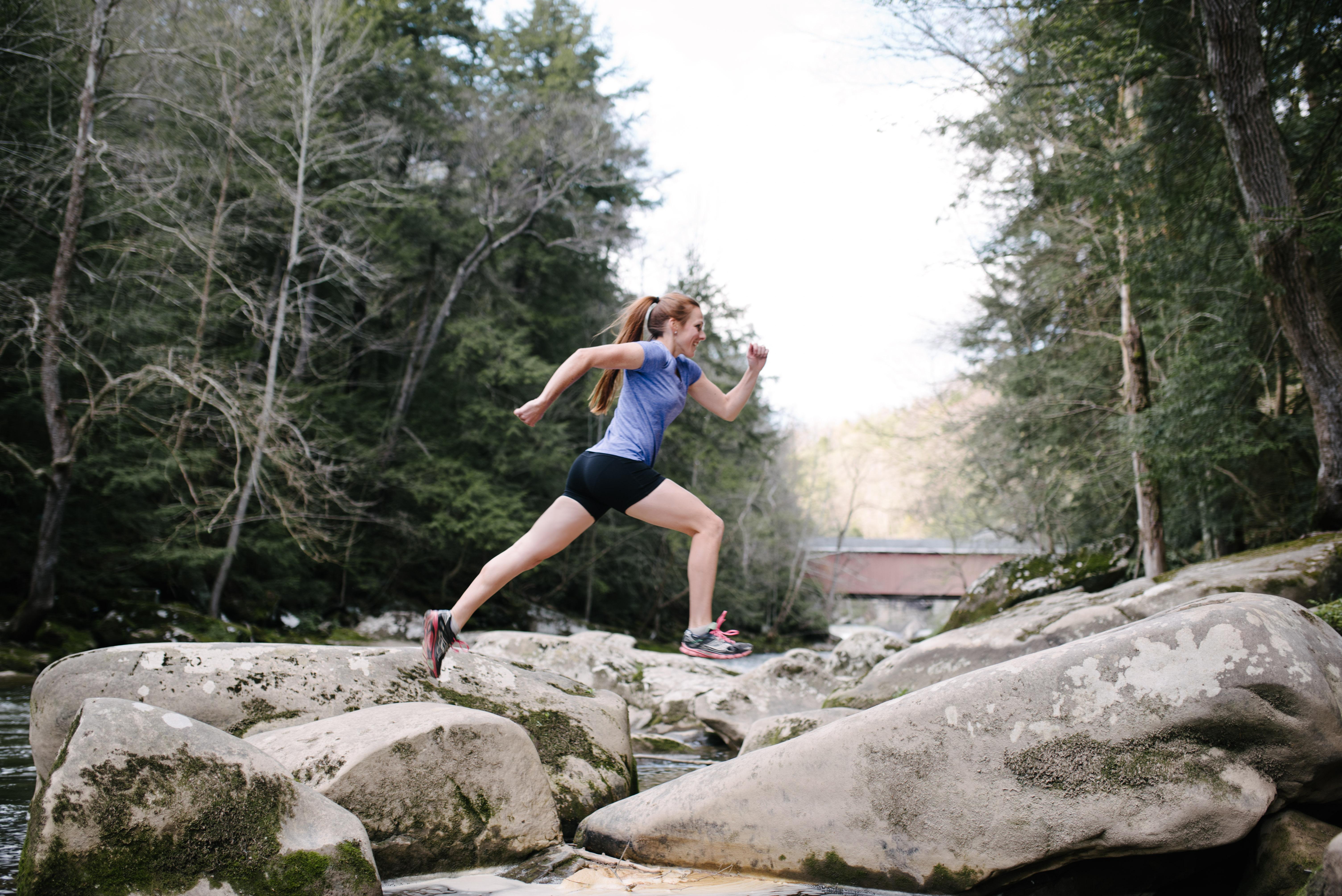 jenni hulburt jumping across rocks